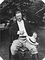Theodore Roosevelt seated in a chair